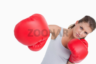 Serious woman boxing