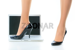 Women's legs and the laptop.