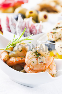 Spanish tapas with seafood and dry sausages