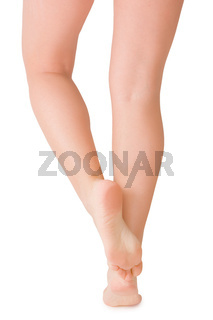 Female feet isolated on white background