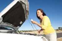 Woman checking oil car