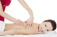Preaty woman relaxing beeing massaged in spa
