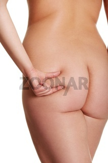Nude woman's bottom with cellulite.