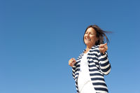 Funny mature woman sky background