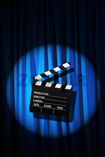 Movie clapper board against curtain