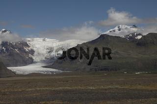 Hvannadalshnúkur and Svínafellsjökull. Hvannadalshnúkur (2110m) is the highest peak in Iceland. Svínafellsjökull is one of the outlet glaciers (glacier tongues) of the Vatnajökull ice cap. Skaftafell
