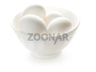 White bowl with white eggs.