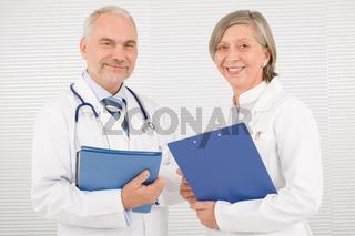 Medical doctor team seniors smiling hold folders