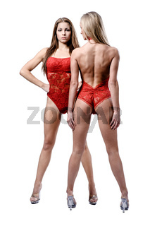 Two beautiful athletic girl posing over white background