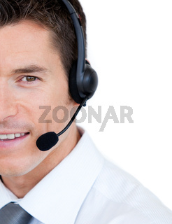 Portrait of a sales representative man with an headset against white background