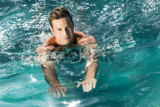 young man swimming