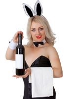 Waitress in bunny suit shows a bottle of wine