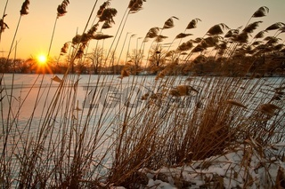 Beautiful winter sunset on the frozen lake