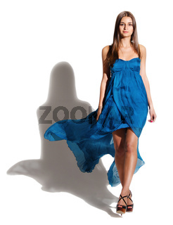 Portrait of the beautiful girl in long blue dress
