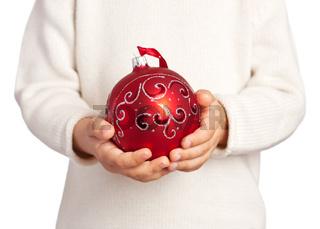 Children's hands holding Christmas ball