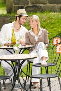 Restaurant terrace elegant couple celebrate sunny day