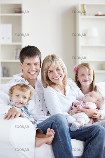 Attractive happy family with children at home