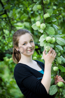 teenage girl at apple tree