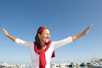 Joyful mature woman marina holiday