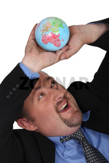 Businessman collapsing under the weight of the world