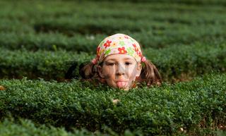 girl playing hide and seek