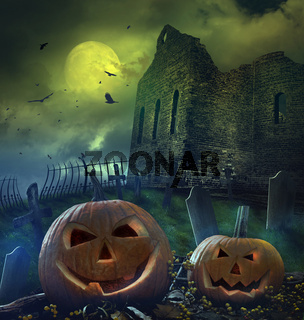 Pumpkins in graveyard with church ruins