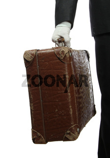 butler with white glove and old suitcase