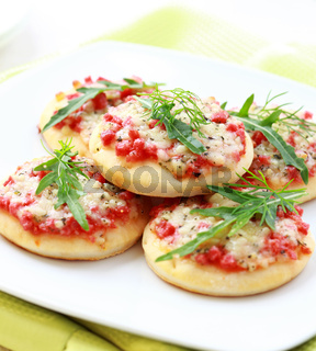 Small cakes with ham and cheese as appetizer