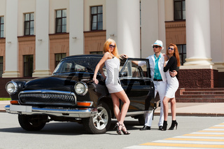 Young people with a retro car
