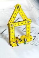 Workmen on a blueprint building site