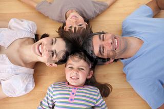Lively family lying on the floor