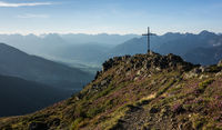 Cross on a mountain peak in Tyrol Austria