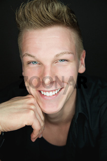 Portrait of a beautiful friendly young blond man