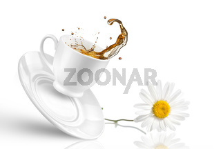Splash of tea in the falling cup with flower isolated on white