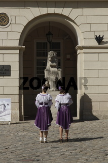 Two girls in front of the Town Hall in the Old Town of Lviv (Lwów)