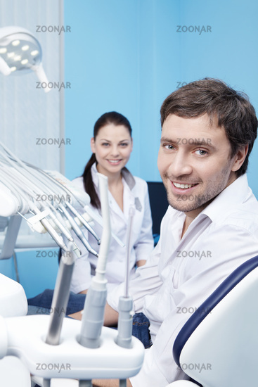 An attractive man at a reception at the dentist