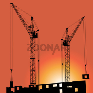 Silhouettes of crane on building against