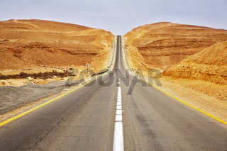 The highway in desert in spring day