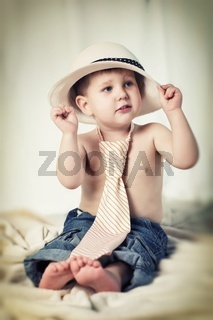 Portrait of the little boy with hat on head