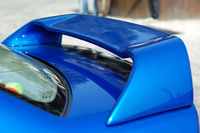 The rear part of a sportive car with detail