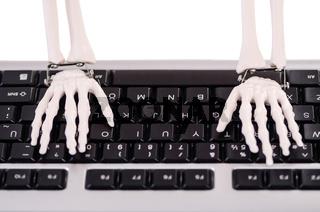 Skeleton working on the keyboard