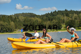 Young people sunbathing on kayak