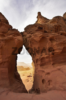 Through  arch in red mountains