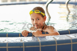 Cute child with goggles relaxing at whirlpool