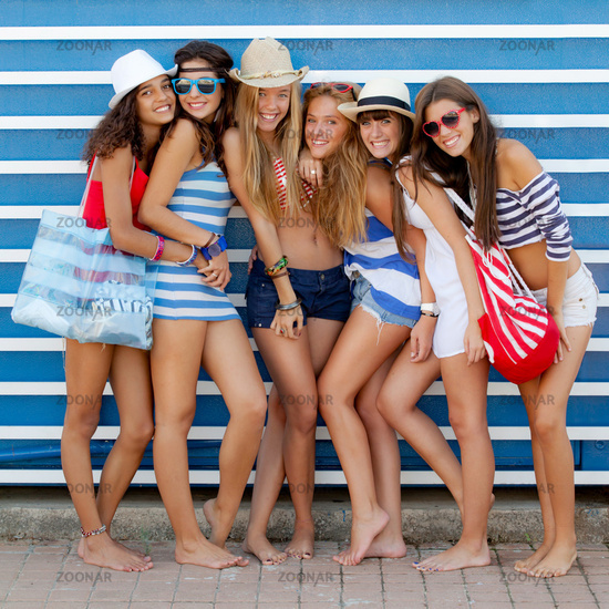 diverse group of girls going to beach on summer va