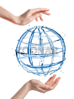 Globe from water with human hand isolated on white