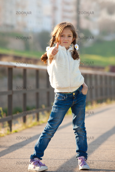 child with thumb up for success