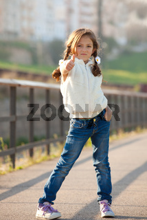 child with thumb up