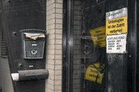 locked front door with prohibitive signs and full