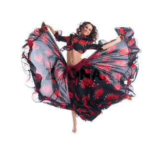Beauty girl jump in gypsy dance isolated